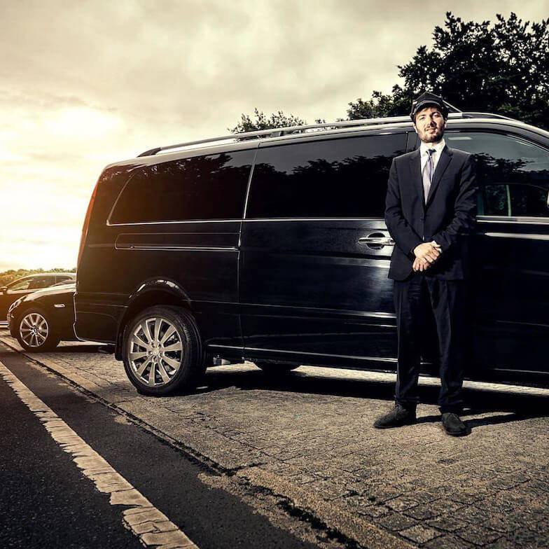 man standing in front of van